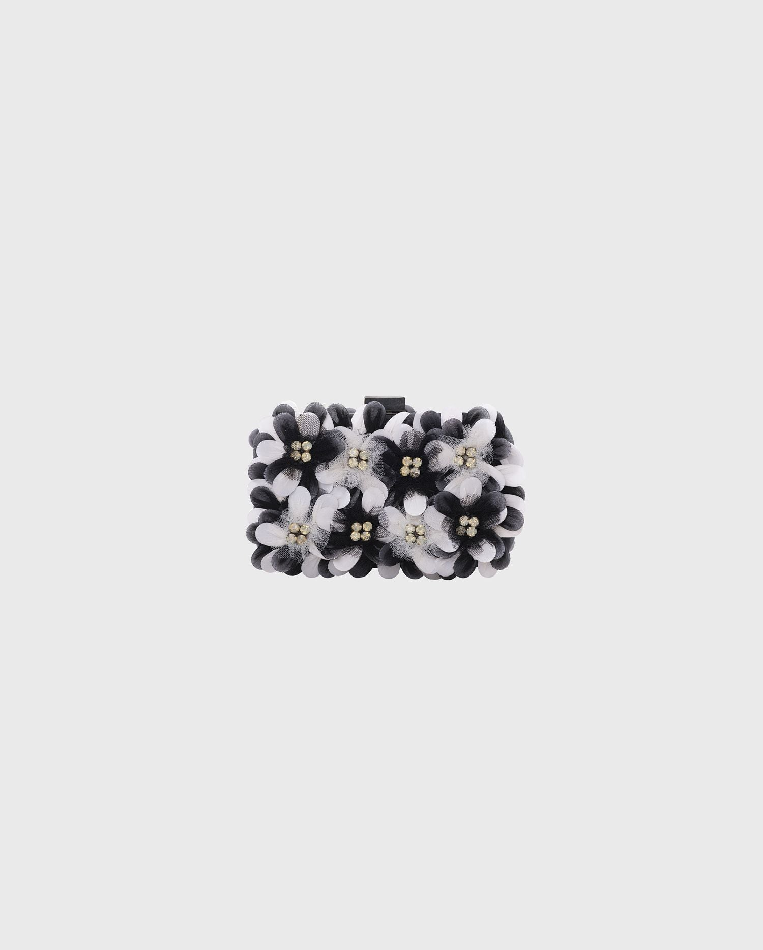 The FAUVE floral black and white box clutch is the perfect style to add to your look