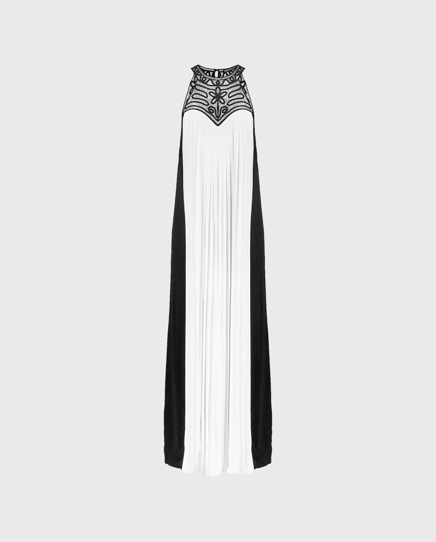 The VOLUPTA white and black maxi dress is the perfect look for making an entrance for your next event.